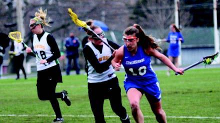 Erin Tornatore fights off Corinne Marsh
