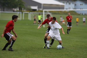 Ryan Tibbetts protects the ball