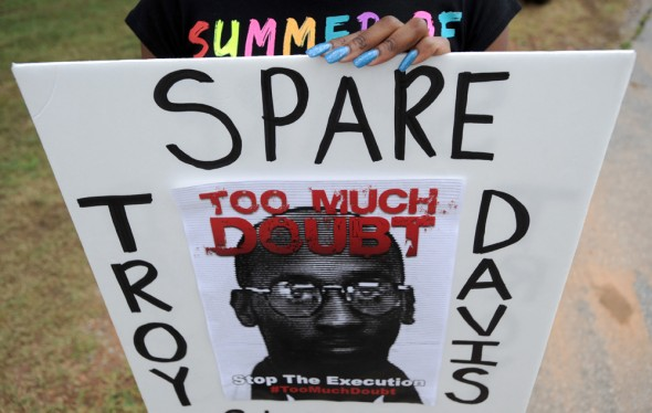 Sign encouraging the government to spare Troy Davis