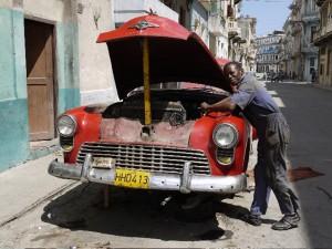 Jubin Man repairing Oldsmobile