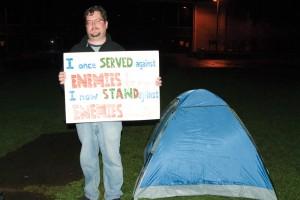 Matthew Harmer participates in the Occupy Oswego movement