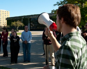 Protestors with a megaphone in the Quad
