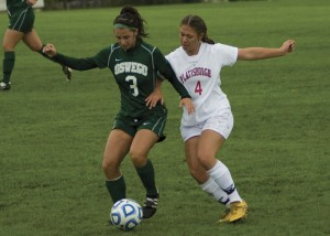 Oswego's Raquel Vescio keeps the ball away from Plattsburgh's Sidney Flint