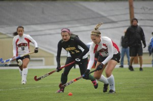 Taylor Stein chases down an Oneonta player