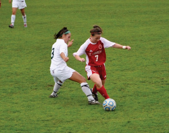 Raquel Vescio attempts to kick the ball away from St. Lawrence junior midfielder Brooke Hessney