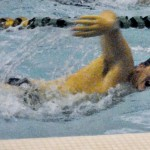 Swimming and diving teams each lose close matches