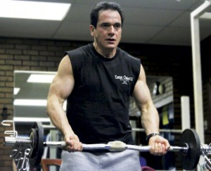 Bob Natoli lifts dumbbells