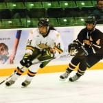 Women's hockey falls in opening game