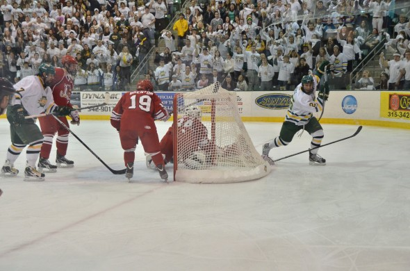 Senior forward Chris Muise scores Oswego's lone goal against Plattsburgh.