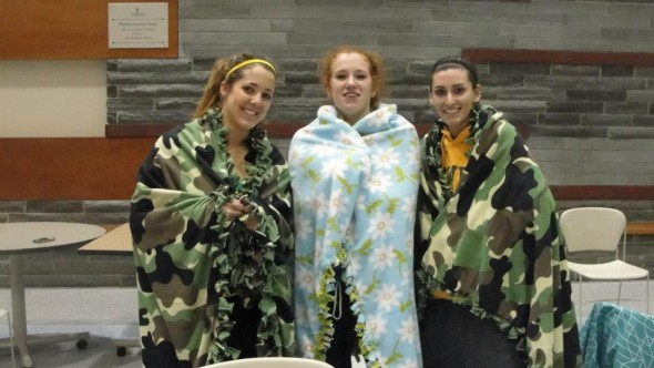 Oswego State students participate in the Crafty No Sew Fleece Blanket on Wednesday, Feb. 20. (Photo provided by Campus Recration)