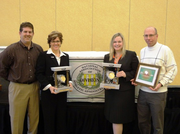 Oswego State Interim Athletic Director Cora Brumley (second from right) with the Jostens/NADIIIAA Community Service trophy awarded to Oswego State. (Photo provided by Sports Information)