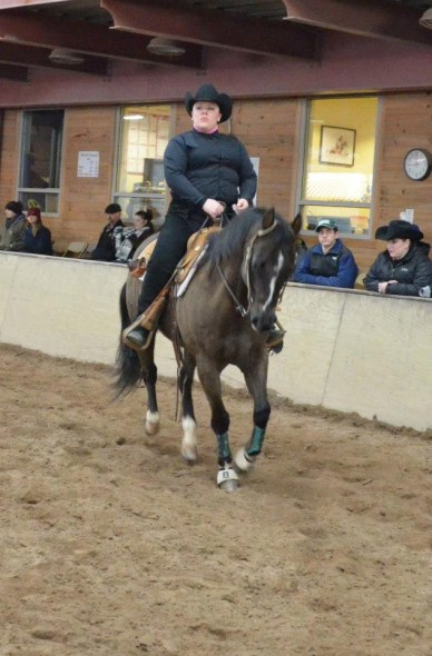 A member of the Oswego State equestrian team performs at the Syracuse Western Show on Saturday. (Photo provided by Equestrian Team)