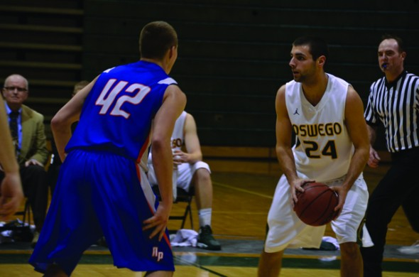 Oswego State freshman guard/forward Alex Rawa handles the ball during the Lakers' 74-57 victory over SUNY New Paltz on Tuesday night at Max Ziel Gymnasium. (Nick Graziano | The Oswegonian)