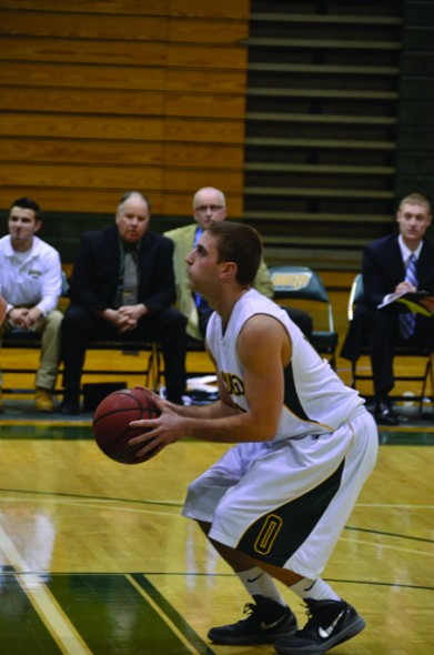 Oswego State senior guard Alex Mirabito attempts a free throw in the Lakers' 74-57 win over New Paltz. (Nick Graziano | The Oswegonian)