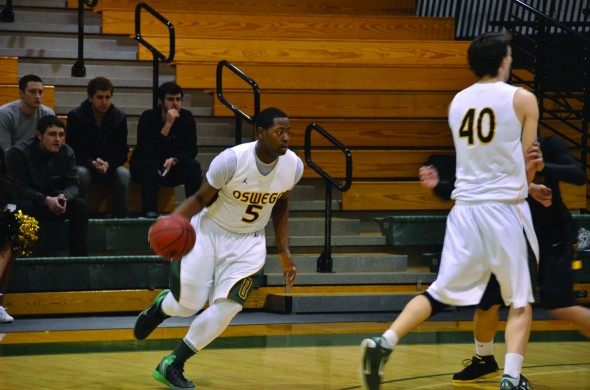 Senior forward Chris Gilkes moves the ball during the Lakers' 78-66 SUNYAC quarterfinal victory over The College at Brockport on Tuesday, Feb. 19. (Nick Graziano | The Oswegonian)