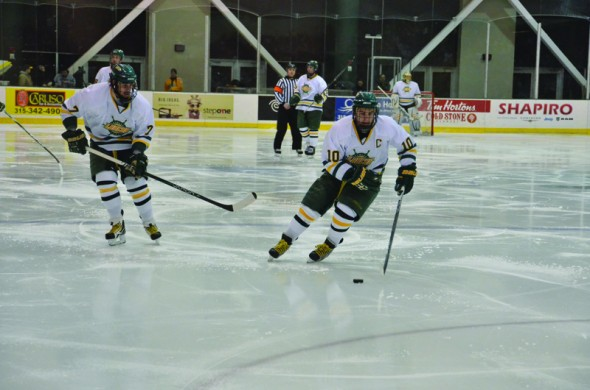 Senior captain Jon Whitelaw handles the puck up the ice as fellow senior Luke Moodie looks on during the Lakers' 3-2 win over Morrisville State on Feb. 1. (Nick Graziano | The Oswegonian)