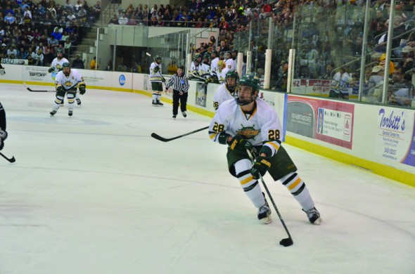 Oswego State senior defender Jesse McConney looks to move up the ice with the puck in the Lakers' 3-2 win over Morrisville State on Friday. (Nick Graziano | The Oswegonian)