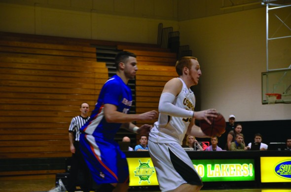 Senior forward Hayden Ward battles a defender during the Lakers' 74-57 victory over SUNY New Paltz on Tuesday, Feb. 5 at Max Ziel Gymnasium. (Nick Graziano | The Oswegonian)