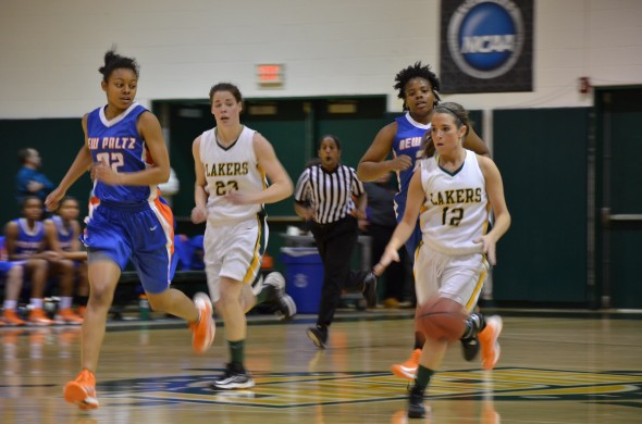 Senior guard Kassie Kleine dribbles up the court during the Lakers' 75-66 loss to SUNY New Paltz on Feb. 5 at Max Ziel Gymnasium. The Lakers are currently 16-7. (Nick Graziano | The Oswegonian)