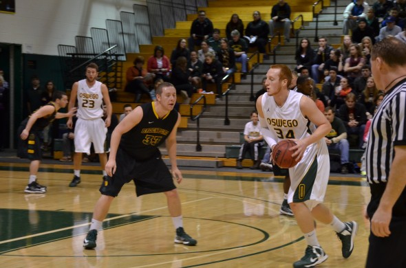 Senior forward Hayden Ward looks to move around a defender during the Lakers' 78-66 playoff victory over The College at Brockport on Tuesday. (Nick Graziano | The Oswegonian)