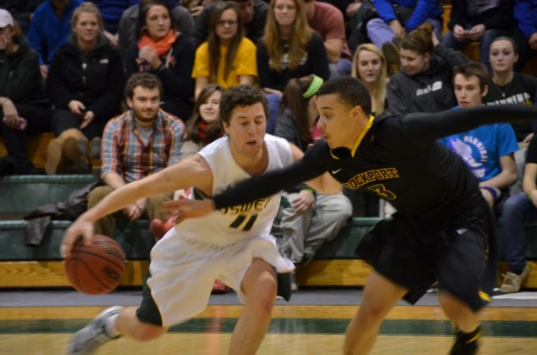 Senior guard Sean Michele tries to get around a defender in the Lakers' win over The College of Brockport. (Nick Graziano | The Oswegonian)