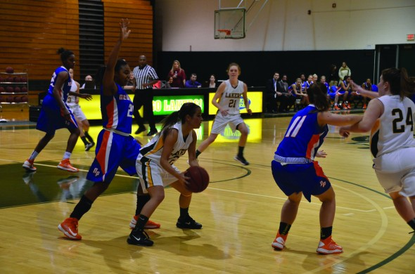 Senior guard Kassie Kleine looks to move the ball during the Lakers' 75-66 loss to SUNY New Paltz on Feb. 5. (Nick Graziano | The Oswegonian)