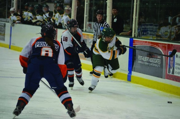 Junior forward Mady Paul skates after the puck during the Lakers' 5-3 victory over Utica College on Saturday, Nov. 3 at the Campus Center Ice Arena. The Lakers need to win one more game to clinch a home playoff game. (Nick Graziano   The Oswegonian)
