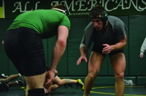 Senior Blake Fisher (right) and junior Maxx Stratton practice against each other on Tuesday at the wrestling room in Laker Hall in preparation for regionals this weekend. (Patrick Malowski | The Oswegonian)