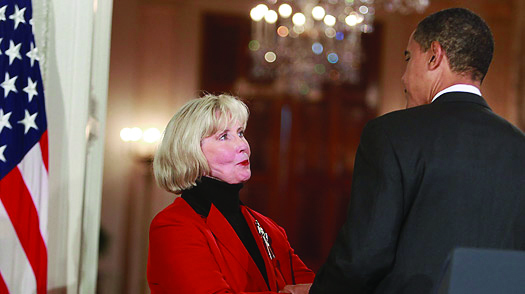 Lilly Ledbetter met with Barack Obama when Obama signed into law the Lilly Ledbetter Fair Pay Act of 2009 which was the first bill signed into law by Obama. (Photo provided by democraticunderground.com)