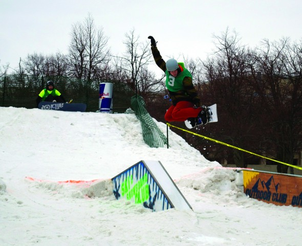 Brian Thayer launches off a ramp as he grabs his snonwboard in the academic quad last Saturday. Rail Jam has become an annual tradition at Oswego State. (Photo provided by Eric Muldoon)