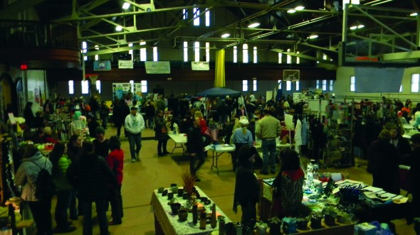 Warm Up Oswego festival-goers crowd the Oswego YMCA Armory gym among the various booths. (Patrick Malowski | The Oswegonian)