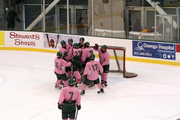 The Oswego State men's club ice hockey team celebrates a win over Binghamton University on Oct. 21. (Photo provided by Dwayne  Niewiemski)