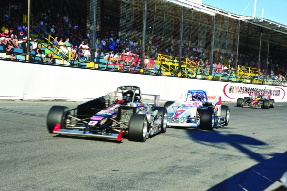Oswego Speedway Supermodified drivers Tim Snyder (left), Joey Payne (center) and Joe Gosek (far right) battle down the front strech of the speedway. (Photo provided by Bill Taylor)
