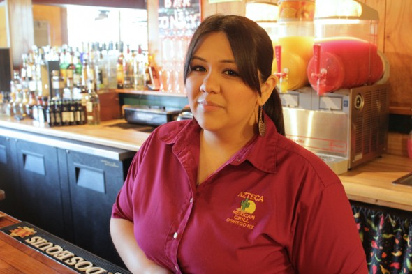 Veronica Valenzuela, daughter of Azteca Mexican Grill in Oswego owners, seen here at the restaurant. (Moraima Capellan | The Oswegonian)