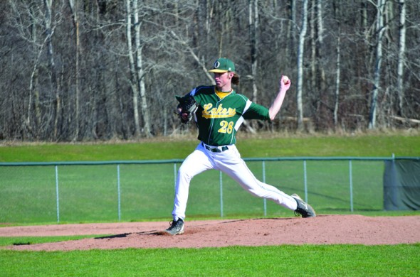 Sophomore pitcher Dylan Kohlman pitches during the second game of the Lakers' home doubleheader against SUNY Cortland.  Cortland took both games. (Nick Graziano | The Oswegonian)
