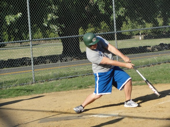 A student takes part in the Campus Recreation spring intramural softball tournament, which began on Wednesday, with the Rolltiders defeating Wordington, 15-9. (Photo provided by Campus Recreation)