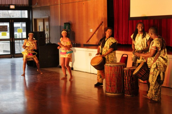 Akuma, an African dance group from Syracuse, performs at the African Student Organization's ninth annual dinner. (Moraima Capellan | The Oswegonian)