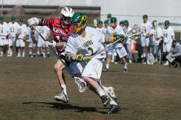 Senior attacker Casey Balzer moves around a defender during the Lakers' 11-10 home overtime loss to SUNY Plattsburgh on Saturday afternoon. (Photo provided by Chuck Perkins Photography)