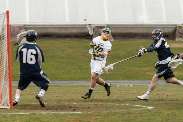 Junior attacker and team captain Chris Porten takes a shot on goal during the Lakers' 14-6 home loss to SUNY Geneseo on Saturday afternoon. (Photo provided by Chuck Perkins Photography)