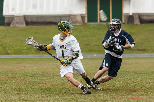 Sophomore attacker Cody Hoose moves with the ball during the Lakers' Saturday loss to Geneseo. (Photo provided by Chuck Perkins Photography)