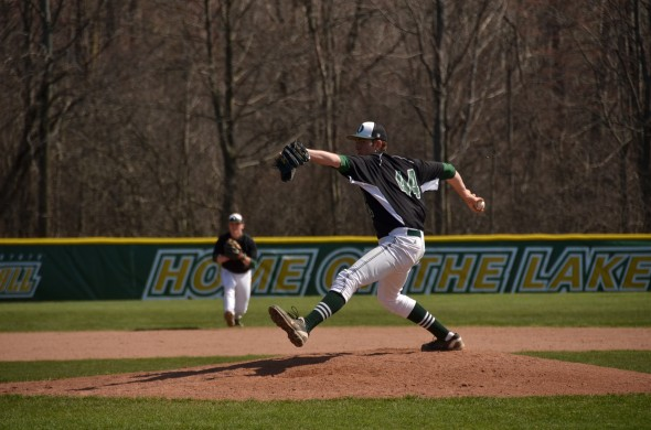 Freshman Jordan Giller pitches during the first game of the Lakers' home doubleheader against Cazenovia College. Oswego State won both games. (Nick Graziano | The Oswegonian)