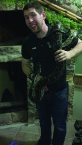 Daniel Oostdyk holds one of his snakes in Grace and Glory Animals, just one of the many reptiles he cares for. (Photo provided by Blaise Hill)