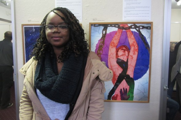 Student artist, Kendi Kajogo, used colors and textures to portray her assigned story. (Devon Nitz | The Oswegonian)