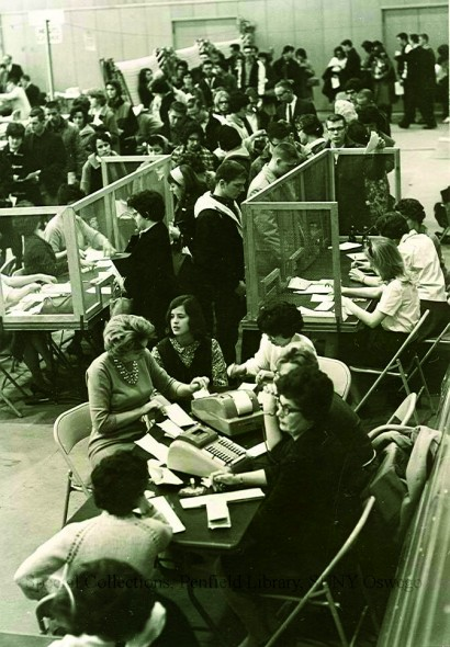 Oswego State students in 1964 crowd around different tables in order to register for classes for the spring semester. (Photo provided by Penfield Library)
