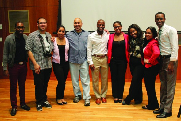 Professor David Moody, Kendis Gibson and students pose together at the Voice of Diversity event on April 18. (Moraima Capellan | The Oswegonian)