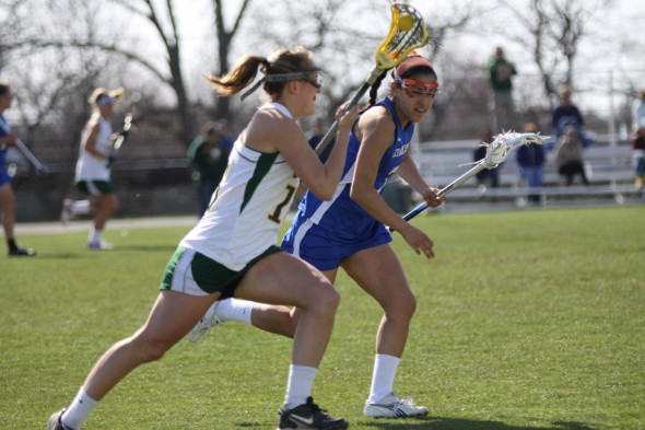 Laker defender junior Megan McNulty brings the ball upfield in Oswego State's 12-7 victory against SUNY New Paltz at Laker Field on Tuesday afternoon. (Photo provided by Sports Information)