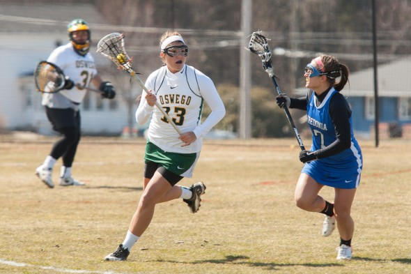 Laker Freshman Erannan Shattuck brings the ball up field in a game against SUNY Fredonia. She has been a difference-maker for the Lakers in her freshman year, as she has paced Oswego State's offense  with a team-leading 26 goals and 42 points. (Photo provided by Sports Information)