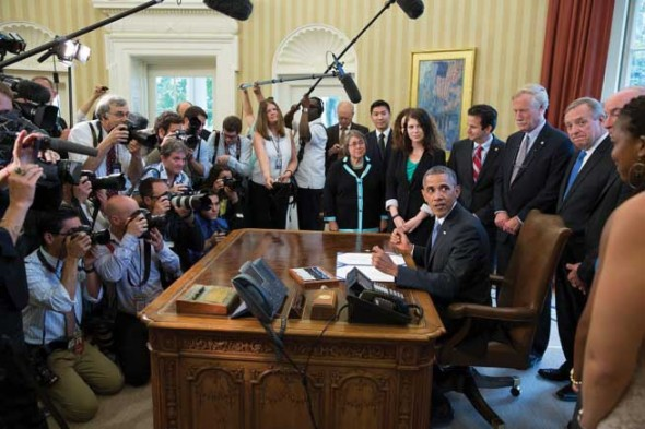 President Obama signs tuition-focused legislation from Oval Office.  (Photo provided by White House)