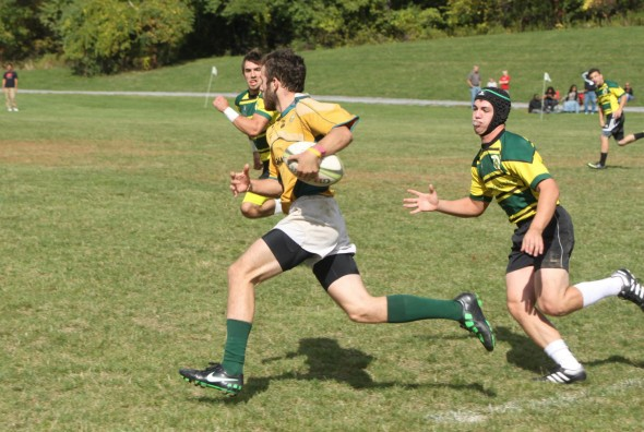 Team captain Connor Murphy runs past the opposing defense and takes off upfield during a game last season for the Oswego State Wizards.  (Photo provided by Reid Adler)