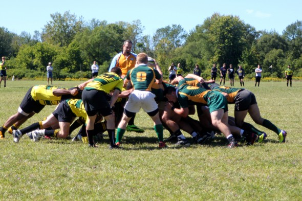 The Oswego State club rugby team (right) defeated Le Moyne College in their 2013 season opener.  (Photo provided by Reid Adler)